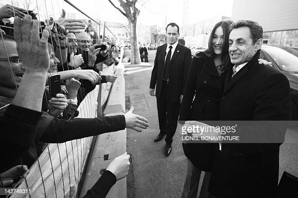 France's First Lady Carla Bruni Sarkozy and France's President and Union for a Popular Movement candidate for 2012 presidential election Nicolas...