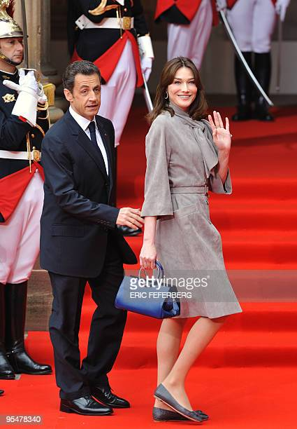 France's first Lady Carla Bruni-Sarkozy and French President Nicolas Sarkozy are pictured on their arrival at the Palais Rohan for the NATO summit in...