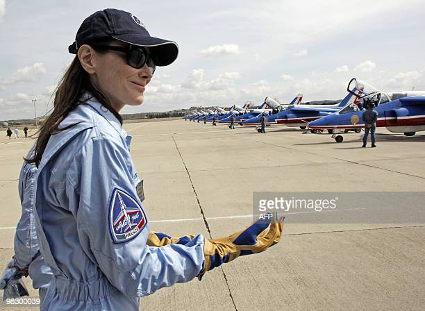France's first lady Carla BruniSarkozy patron of the French aerobatic squadron 'Patrouille de France' walks past Alpha jets after an exhibition in...