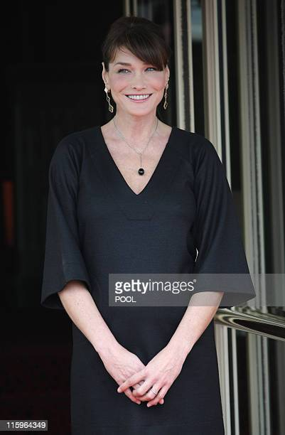 France's First Lady Carla BruniSarkozy waits for the arrival of the wives of the Heads of Delegation of African countries and international...