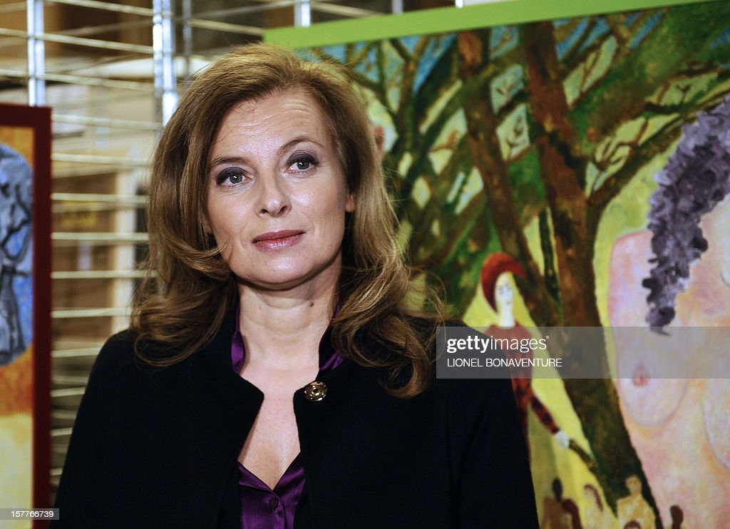 France's First Lady, Valerie Trierweiler is pictured during the visit of an exhibition of paintings by Florence Cassez who is serving a 60-year sentence for kidnapping in a Mexican prison, on December 6, 2012 at the 12th district of Paris. Cassez's case has caused diplomatic tension between France and Mexico since she was arrested and jailed in 2005.