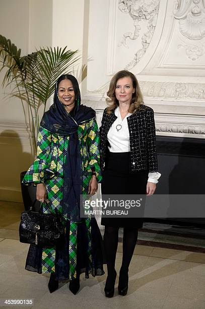 France's first lady Valerie Trierweiler poses with Chads first lady Hinda Deby Itno upon her arrival at Orsay Museum on December 6 2013 in Paris...