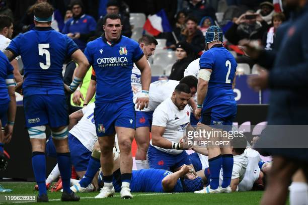 France's flanker Charles Ollivon reacts with France's prop Mohamed Haouas after scoring a try during the Six Nations rugby union tournament match...