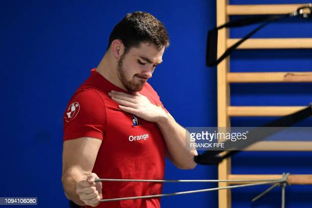 France's flanker Fabien Sanconnie grimaces as he takes part in an indoor training session on February 5, 2019 in Marcoussis, south of Paris, as part...