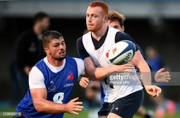 France's flanker Gregory Alldritt fights for the ball with France's lock Kilian Geraci during a training session on October 21 2020 in Marcoussis...