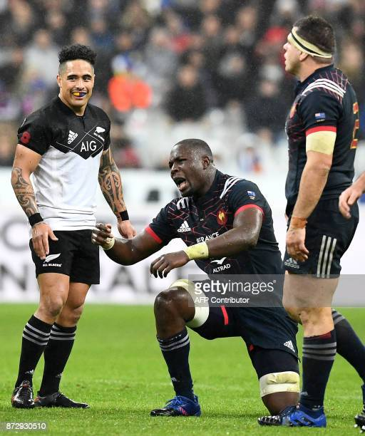 France's flanker Judicaël Cancoriet reacts as New Zealand's scrumhalf Aaron Smith looks on during the friendly rugby union international Test match...