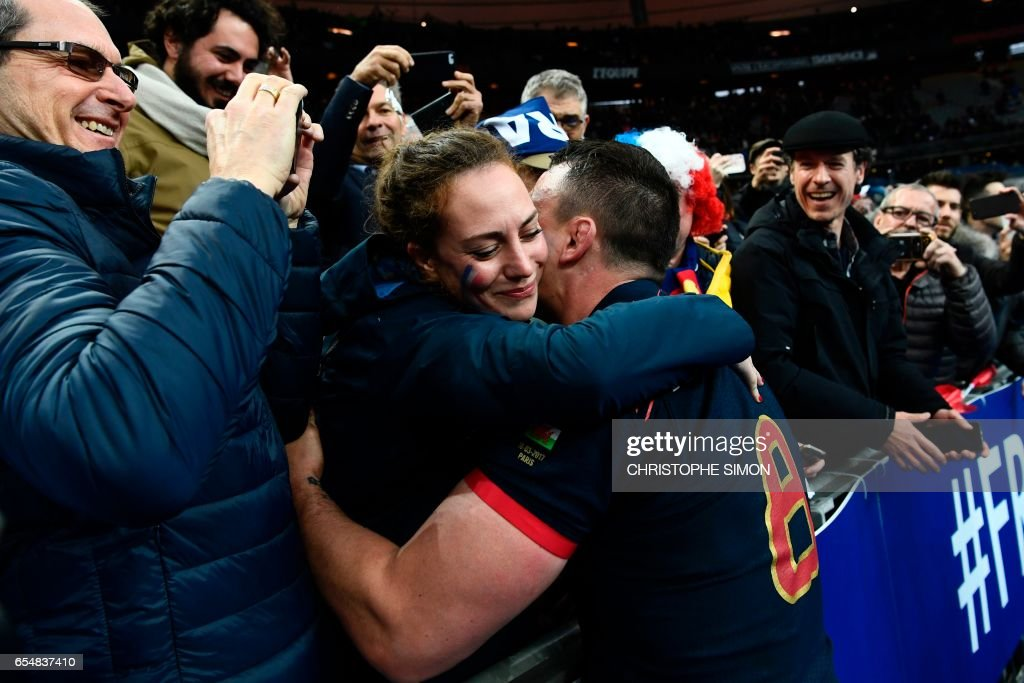 TOPSHOT - France's flanker Louis Picamoles (C) celebrates with fans at the end of the Six Nations tournament Rugby Union match between France and Wales at the Stade de France in Saint-Denis, outside Paris, on March 18, 2017. /