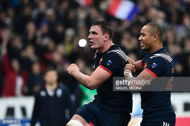 France's flanker Louis Picamoles celebrates with France's winger Virimi Vakatawa after scoring a try during the rugby union Test match between France...