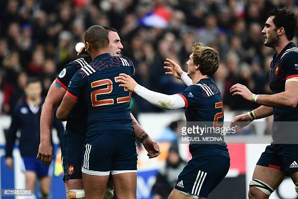 France's flanker Louis Picamoles celebrates with teammates after scoring a try during the rugby union Test match between France and New Zealand on...