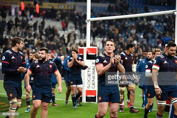 France's flanker Louis Picamoles reacts with teammates after loosing the rugby union Test match between France and New Zealand on November 26 at the...