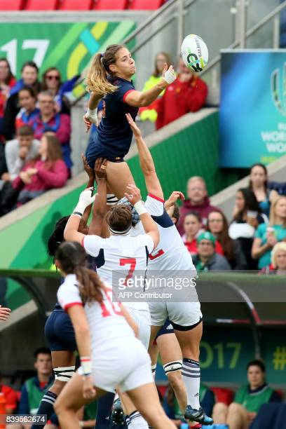 France's flanker Marjorie Mayans jumps for the ball during the Women's Rugby World Cup 2017 Bronze medal match between France and USA at The Kingspan...