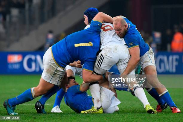 France's flanker Wenceslas Lauret is tackled by Italy's prop Andrea Lovotti and Italy's hooker Leonardo Ghiraldini during the Six Nations...