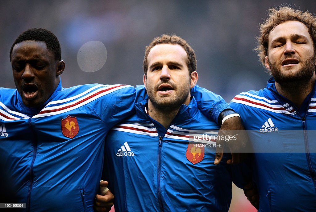 France's flanker Yannick Nyanga, fly half Frederic Michalak and lock Antonie Claassen sing the national anthem before the Six Nations rugby union match between England and France at Twickenham stadium in London on February 23, 2013.