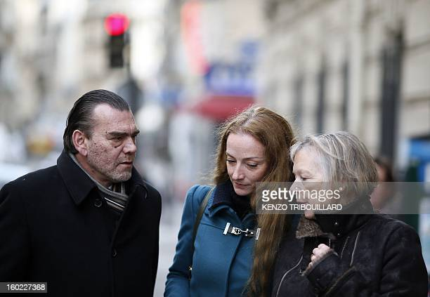 France's Florence Cassez flanked by her mother Charlotte Cassez and her lawyer Frank Berton leaves after a lunch with former French president Nicolas...
