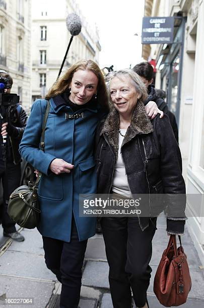 France's Florence Cassez walks in a street of Paris with her mother Charlotte after a lunch with former French president Nicolas Sarkozy on January...