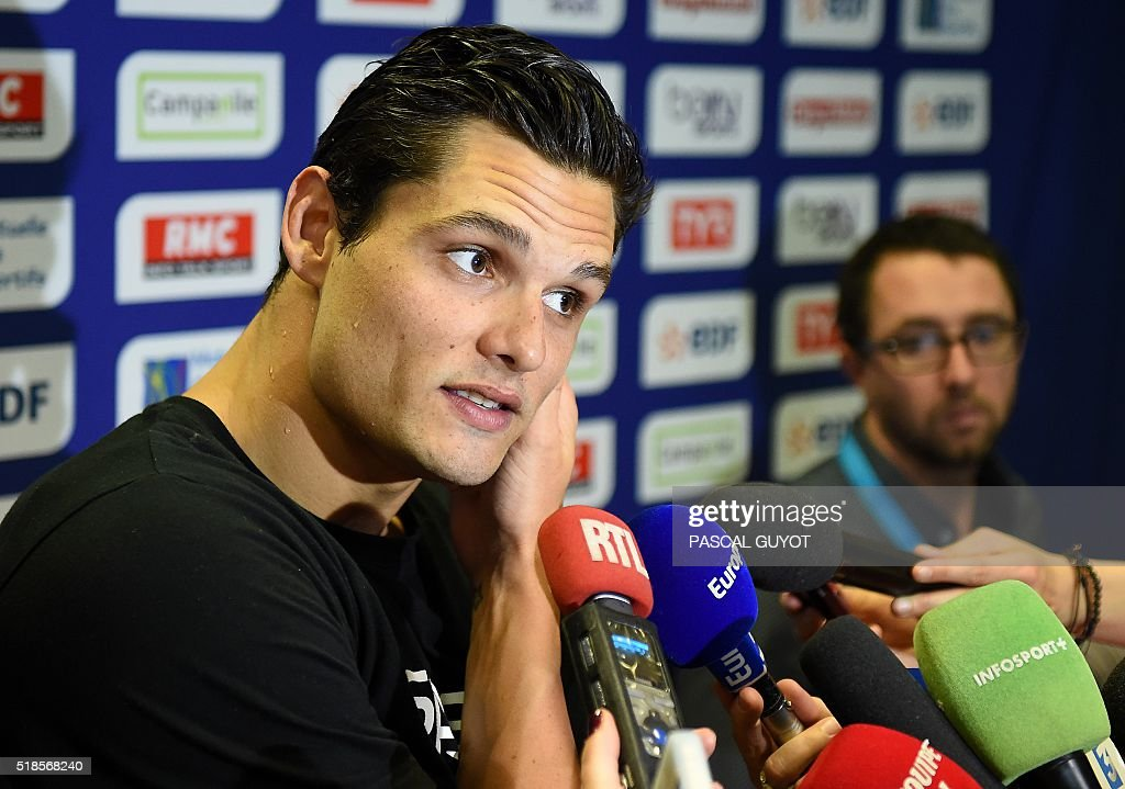 France's Florent Manaudou answers journalists' questions after taking third place in the men's 100m freestyle final of the French swimming championship in Montpellier, southern France, on April 1, 2016. Manaudou failed to qualify in the 100m event for 2016 Olympic Games in Rio de Janeiro. / AFP / PASCAL