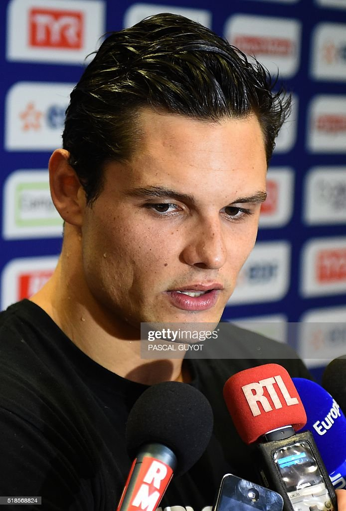 France's Florent Manaudou (L) answers journalists' questions after taking third place in the men's 100m freestyle final of the French swimming championship in Montpellier, southern France, on April 1, 2016. Manaudou failed to qualify in the 100m event for 2016 Olympic Games in Rio de Janeiro. / AFP / PASCAL