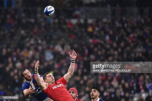 France's fly half Camille Lopez and Wales' winger George North eye the ball during the Six Nations rugby union tournament match between France and...