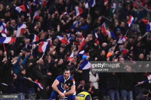 France's fly half Camille Lopez celebrates with teammates after scoring a drop kick during the Six Nations rugby union tournament match between...