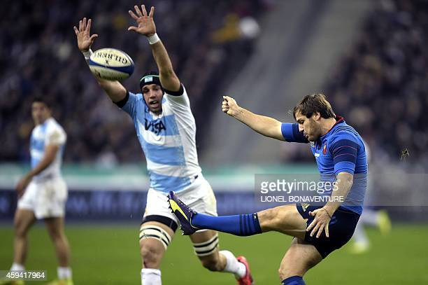 France's fly half Camille Lopez kicks the ball during the international rugby test match France vs Argentina on November 22 2014 at the Stade de...
