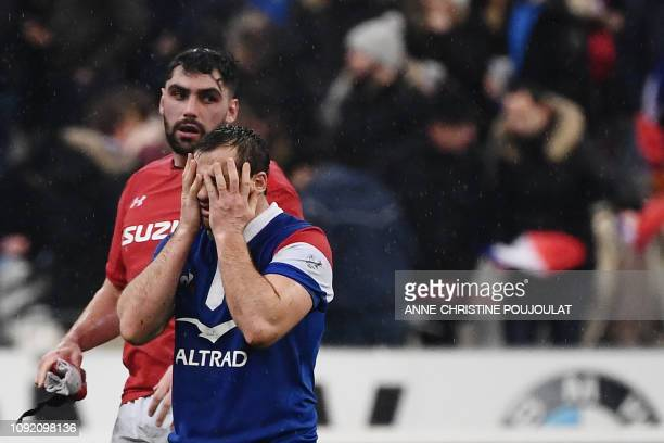 France's fly half Camille Lopez reacts at the end of the Six Nations rugby union tournament match between France and Wales at the stade de France in...