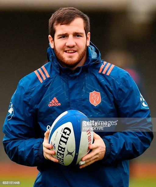 France's fly half Camille Lopez runs with a ball during a training session on January 31 2017 in Marcoussis south of Paris as part of the preparation...