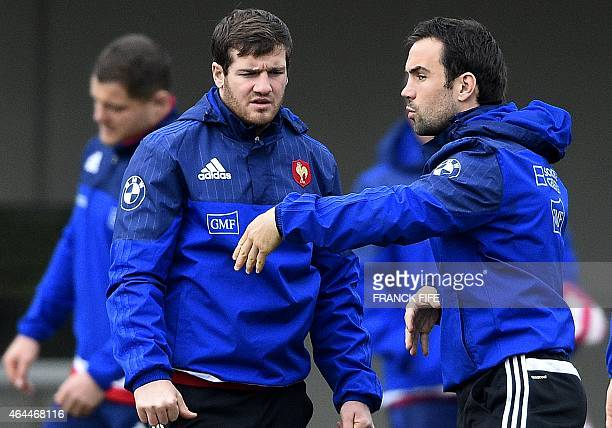 France's fly half Camille Lopez speaks with France's scrum half Morgan Parra during a training session on February 26 2015 in Marcoussis south of...