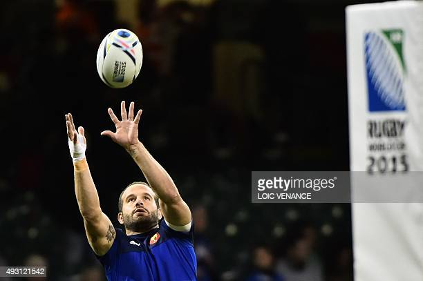 France's fly half Frederic Michalak warms up prior to a quarter final match of the 2015 Rugby World Cup between New Zealand and France at the...