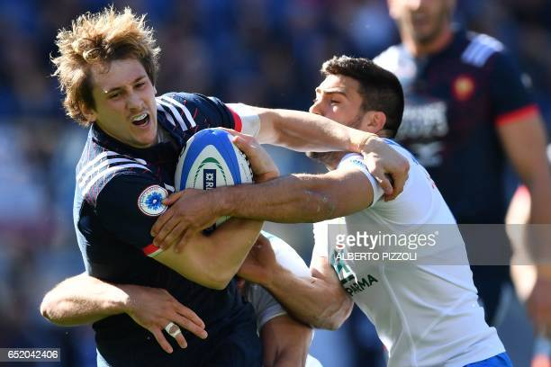 TOPSHOT France's flyhalf Camille Lopez fights for the ball during the International Six Nations rugby union match Italy vs France on March 11 2017 at...
