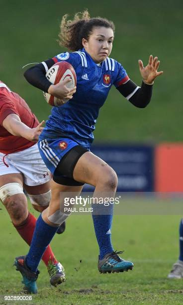 France's flyhalf Caroline Drouin runs to score the team's second try during the Women's Six Nations international rugby union match between Wales and...