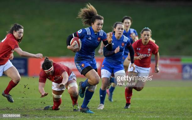 France's flyhalf Caroline Drouin runs with t he ball to score the team's second try during the Women's Six Nations international rugby union match...