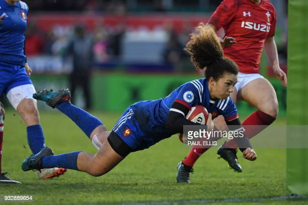 France's flyhalf Caroline Drouin scores the team's second try during the Women's Six Nations international rugby union match between Wales and France...