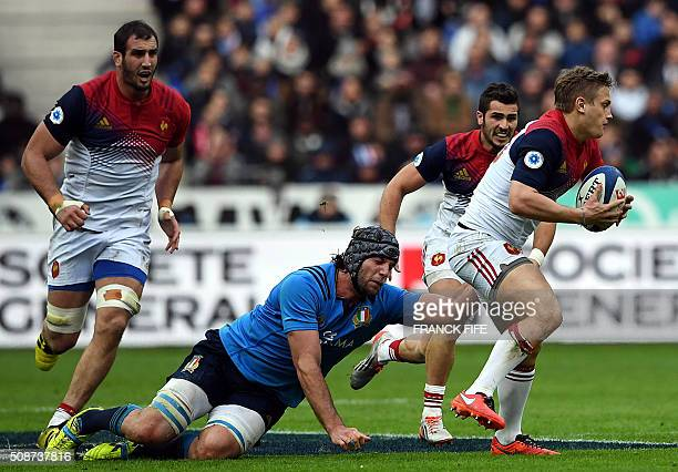 France's flyhalf Jules Plisson runs to evade Italy's lock Marco Fuser during the Six Nations international rugby union match between France and Italy...
