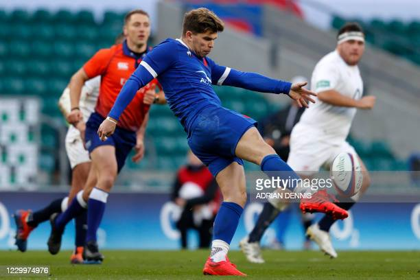 France's fly-half Matthieu Jalibert kicks the ball up-field during the final of the Autumn Nations Cup international rugby union series between...