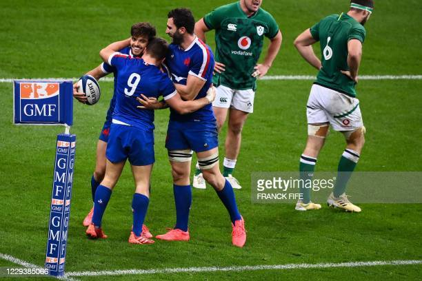 France's fly-half Romain Ntamack celebrates with teammates after scoring a try during the Six Nations rugby union tournament match between France and...
