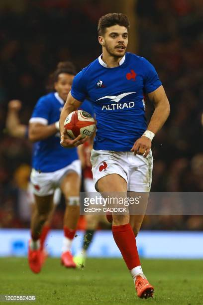France's fly-half Romain Ntamack runs in his breakaway try during the Six Nations international rugby union match between Wales and France at the...