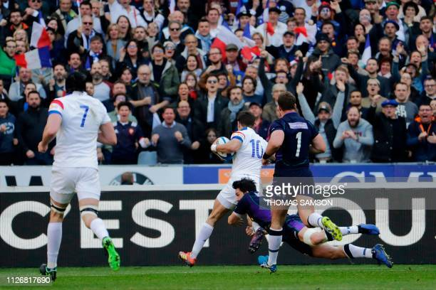 France's flyhalf Romain Ntamack runs to score a try during the Six Nations rugby union tournament match between France and Scotland at the Stade de...