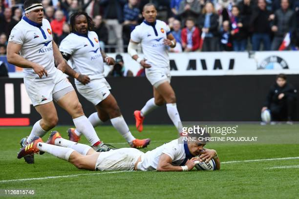 France's flyhalf Romain Ntamack scores a try during the Six Nations rugby union tournament match between France and Scotland at the Stade de France...