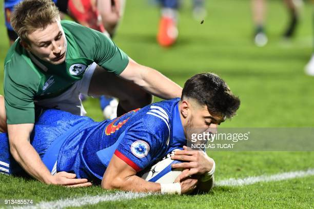France's flyhalf Romain Ntamack scores a try during the Six Nations U20 rugby union match between France and Ireland at the ChabanDelmas Stadium in...