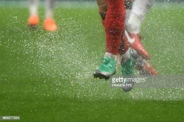 TOPSHOT France's football player runs under the rain during the friendly football match between France and Ireland at the Stade de France stadium in...