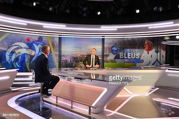 France's football team head coach Didier Deschamps and French journalist Gilles Bouleau arrive to take part in the broadcast news of French TV...