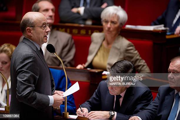 France's Foreign Affairs Minister Alain Juppe delivers a speech in front of Prime Minister Francois Fillon during the weekly session of questions to...