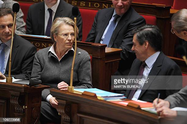 France's Foreign Affairs Minister Michele AlliotMarie chats with France's Prime Minister Francois Fillon next to France's Industry Minister Eric...