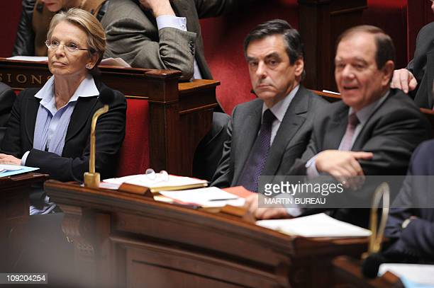 France's Foreign Affairs Minister Michele AlliotMarie listens to a speech next to Prime minister Francois Fillon and Junior minister for Relations...