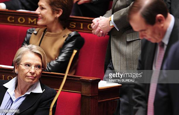 France's Foreign Affairs Minister Michele AlliotMarie looks at her companion junior minister for Relations with the Parliament Patrick Ollier during...
