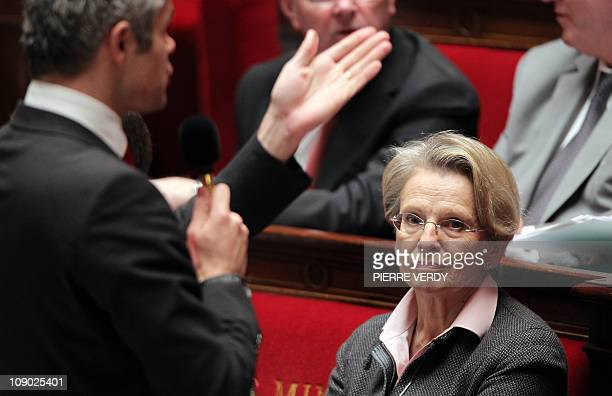 France's Foreign Affairs Minister Michele AlliotMarie sits in front of European Affairs Minister Laurent Wauquiez speaking during the traditionnal...
