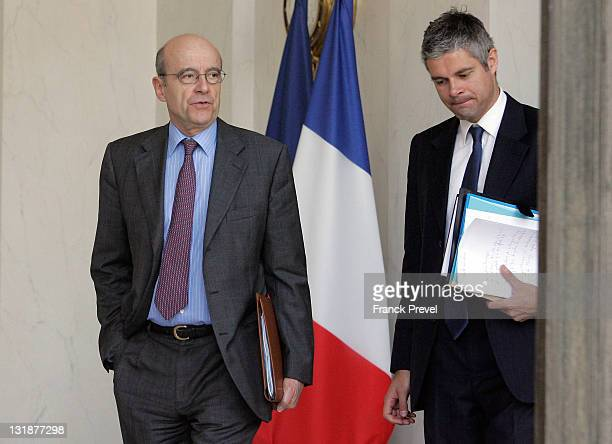 France's Foreign minister Alain Juppe and European Affairs minister Laurent Wauquiez leave the weekly cabinet meeting at Elysee Palace on March 23...