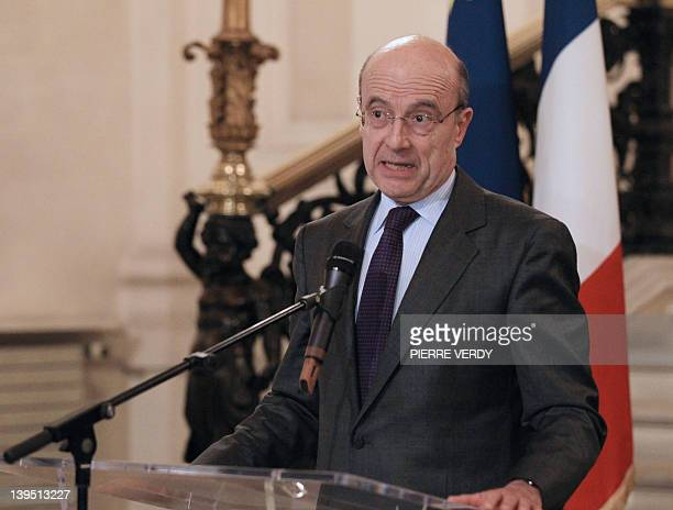 France's Foreign Minister Alain Juppe speaks to journalists at his ministry the Quai d'Orsay on February 22 2012 after the death of two journalists...