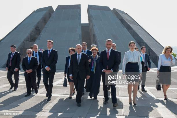 France's Foreign Minister JeanYves Le Drian visits the Tsitsernakaberd Armenian Genocide Memorial in Yerevan on May 28 2018