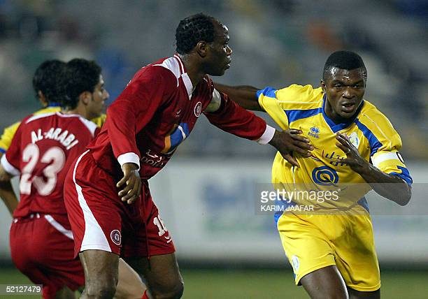 France's former captain Marcel Desailly of alGharrafa club vies with alArabi club player Nigerian soccer star Taribo West during their Qatari league...